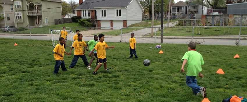 Assisting Community Transformation Kids Playing Soccer BRKC