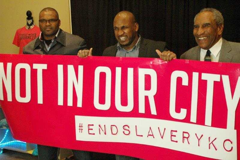 Kansas City Chiefs players hold Not in Our City Banner